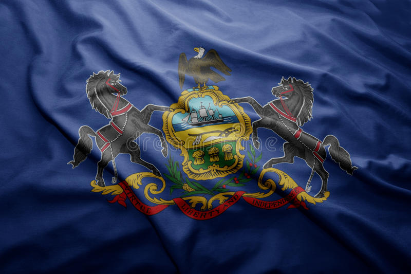Flag of Pennsylvania state. Waving colorful Pennsylvania state flag royalty free stock images