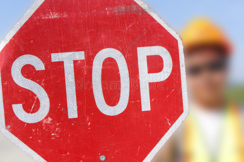 Download Flag Person Holds Stop Sign Stock Image - Image: 25682625