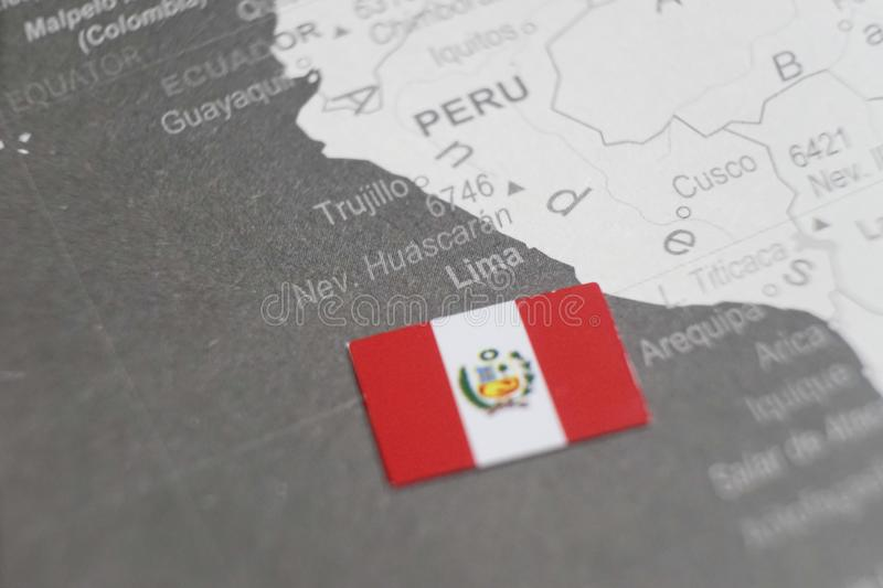 The flag of Peru placed on Lima map of world map stock photo