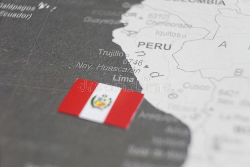 The flag of Peru placed on Lima map of world map royalty free stock photos