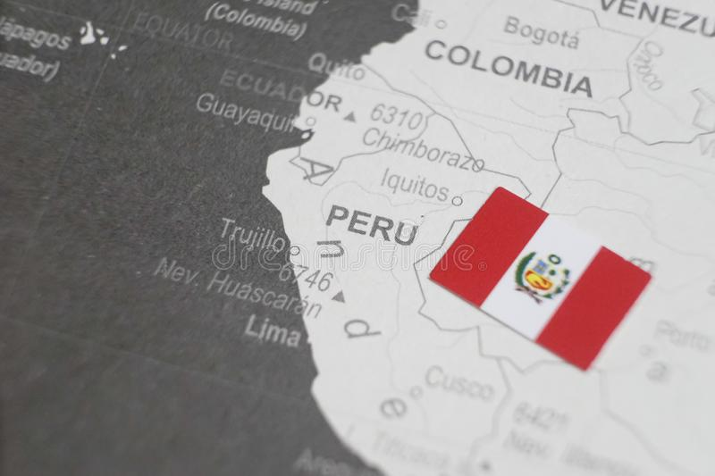 The flag of Peru placed on Peru map of world map stock photos