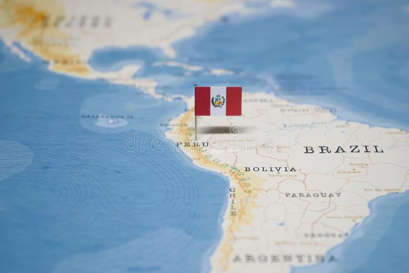 The Flag of peru in the world map stock photo