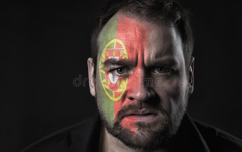 Flag of Portugal on face stock photos