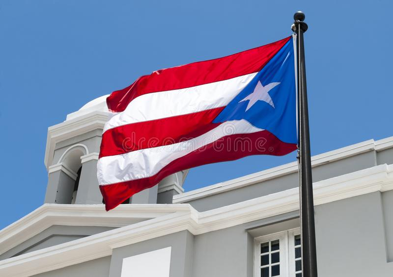 The Flag of Puerto Rico. In the old town of San Juan royalty free stock images