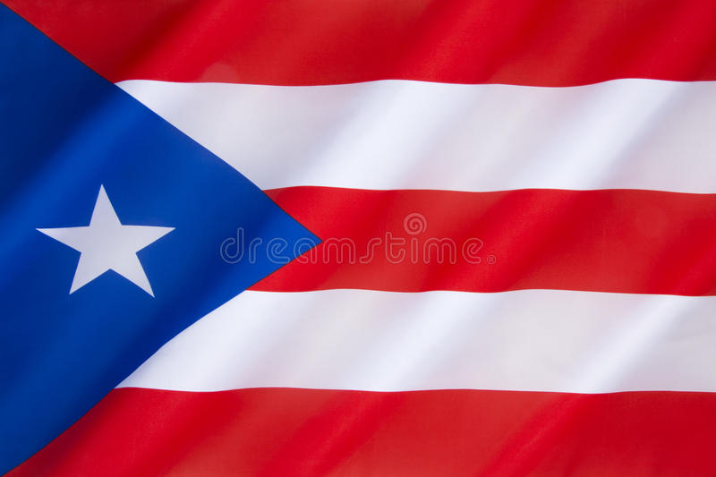 Flag of Puerto Rico. The origins of the current flag, adopted by the commonwealth of Puerto Rico in 1952, can be traced to 1868, when the first Puerto Rican royalty free stock photos