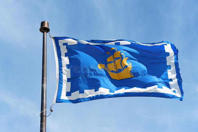 The flag of Quebec City, Canada. The flag of Quebec City waving in the wind. This flag was officially adopted by the city in 1987. On the flag the yellow ship of royalty free stock photography