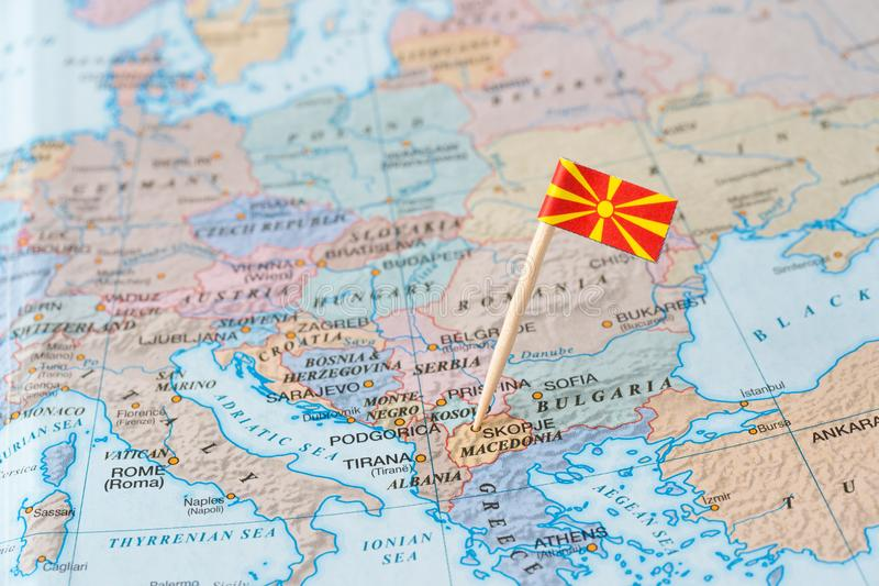 Macedonia map and flag pin. Flag of the republic of Macedonia on map. It is a landlocked country in the Balkan peninsula in Southeast Europe. It is one of the stock photography