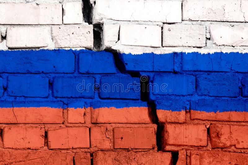 Flag of Russia on the brick wall with big crack in the middle. Destruction and separatism concept.  royalty free stock photos
