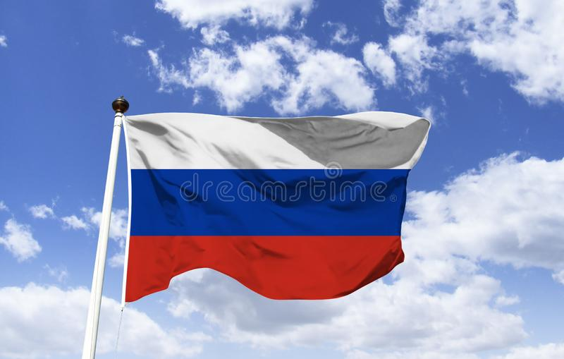 Flag of Russia, trembling under a blue sky. Flag of Russia, tricolor in colors: white symbolizing Christian faith, blue symbolizes truth and Mary the mother of stock photo