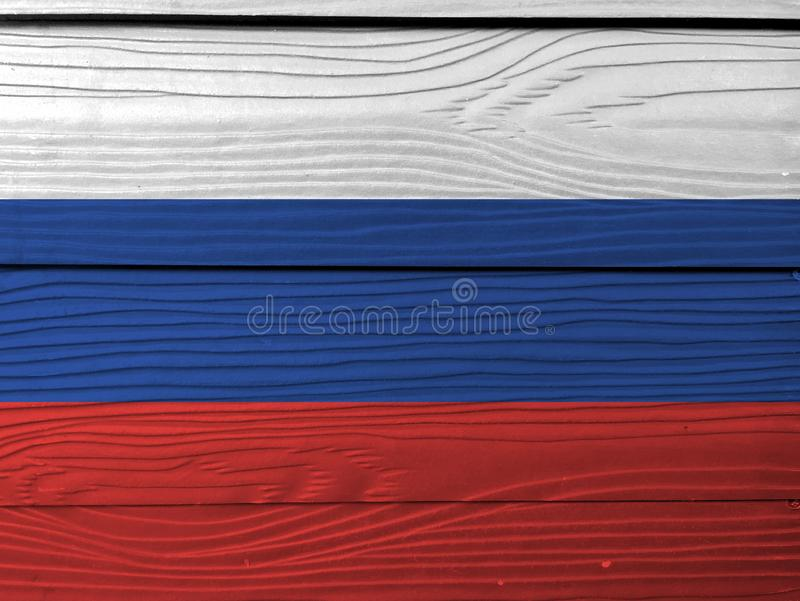 Flag of Russia on wooden wall background. Grunge Russian flag texture. royalty free stock images