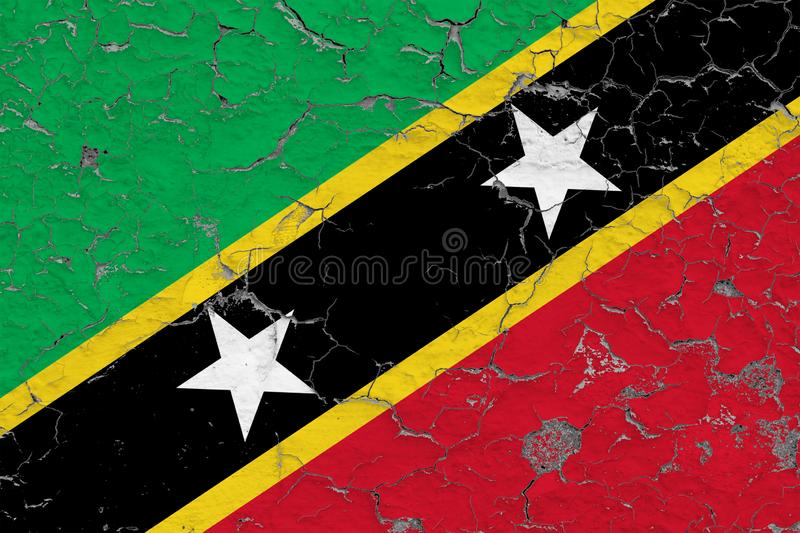 Flag of Saint Kitts And Nevis painted on cracked dirty wall. National pattern on vintage style surface vector illustration