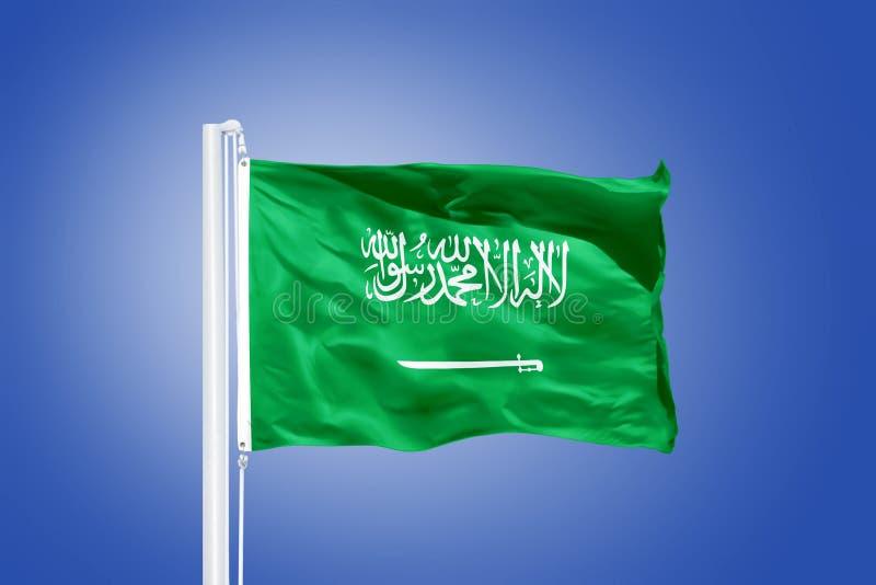 Flag of Saudi Arabia flying against a blue sky.  stock image