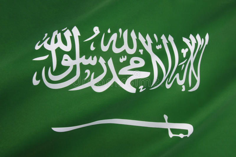 Flag of Saudi Arabia. The flag of Saudi Arabia has been used by the government of Saudi Arabia since March 1973. It is a green flag featuring in white an Arabic stock photography