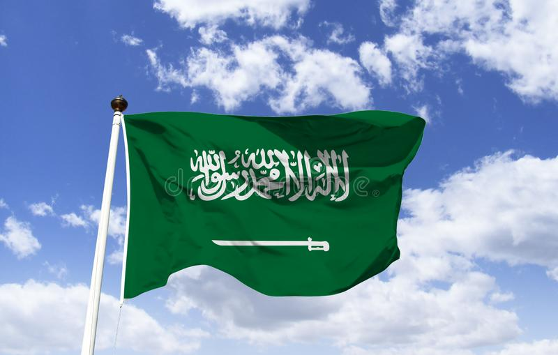 Flag of Saudi Arabia. Official green color symbol with Arabic text on a sword and the declaration of faith: There is no God but Allah, and Muhammad is his stock image