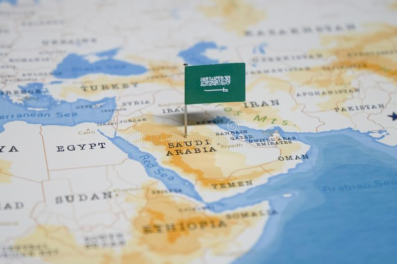 The Flag of saudi arabia in the world map.  royalty free stock photo
