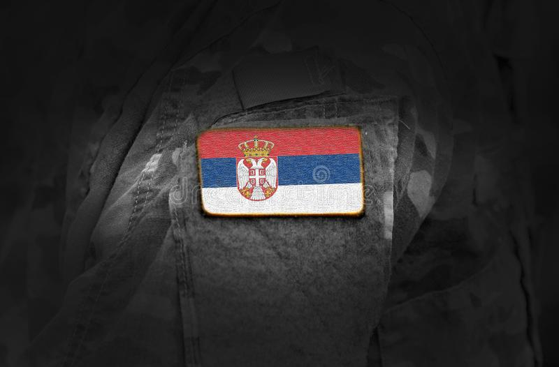 Flag of Serbia on military uniform. Army, armed forces, soldiers. Collage stock photo