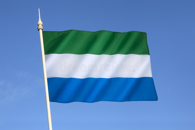 Flag of Sierra Leone. The flag of Sierra Leone - It was adopted in 1961, when Sierra Leone gained independence from Great Britain royalty free stock photos