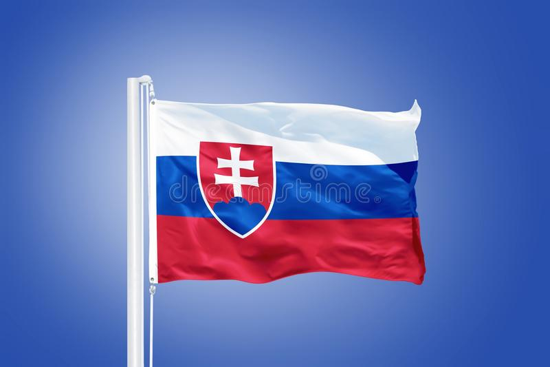 Flag of Slovakia flying against a blue sky.  stock image