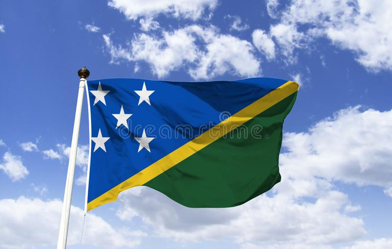 Flag of Solomon Islands, Country in Oceania. Flag of Solomon Islands, fluttering under a blue sky. Country in Oceania, a nation with hundreds of islands located stock photography