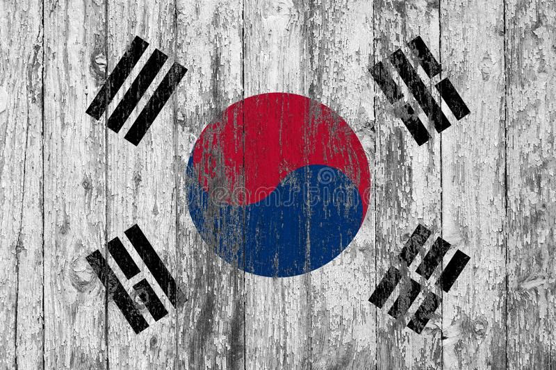 Flag of South Korea painted on worn out wooden texture background royalty free stock images