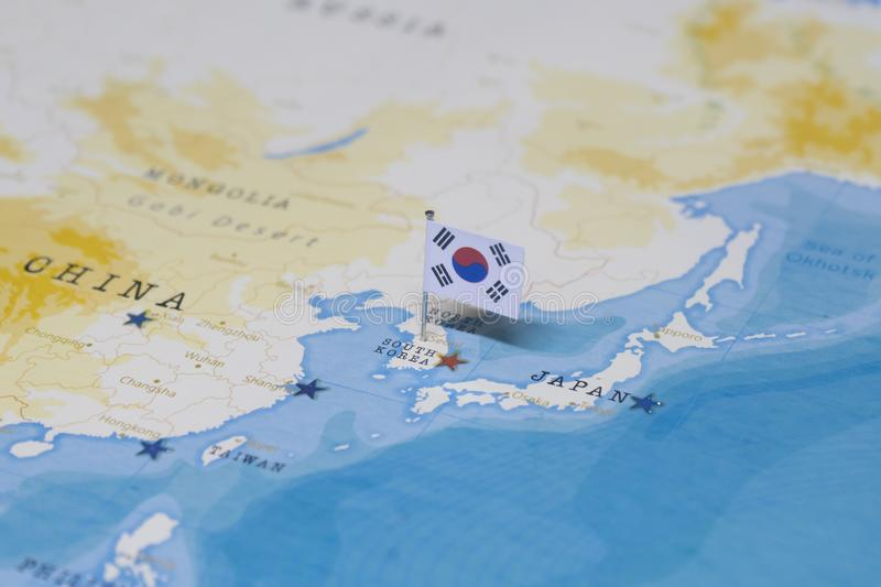 The flag of South Korea in the world map royalty free stock photography