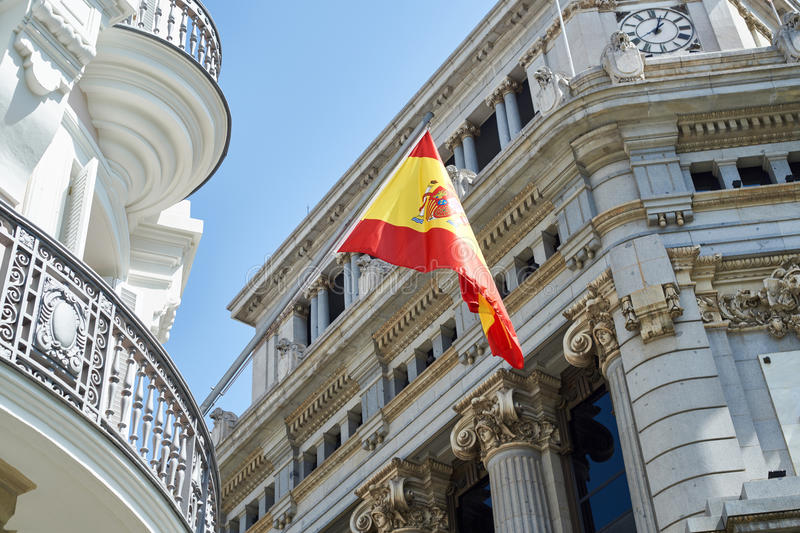 Flag of Spain on building in city Madrid stock images