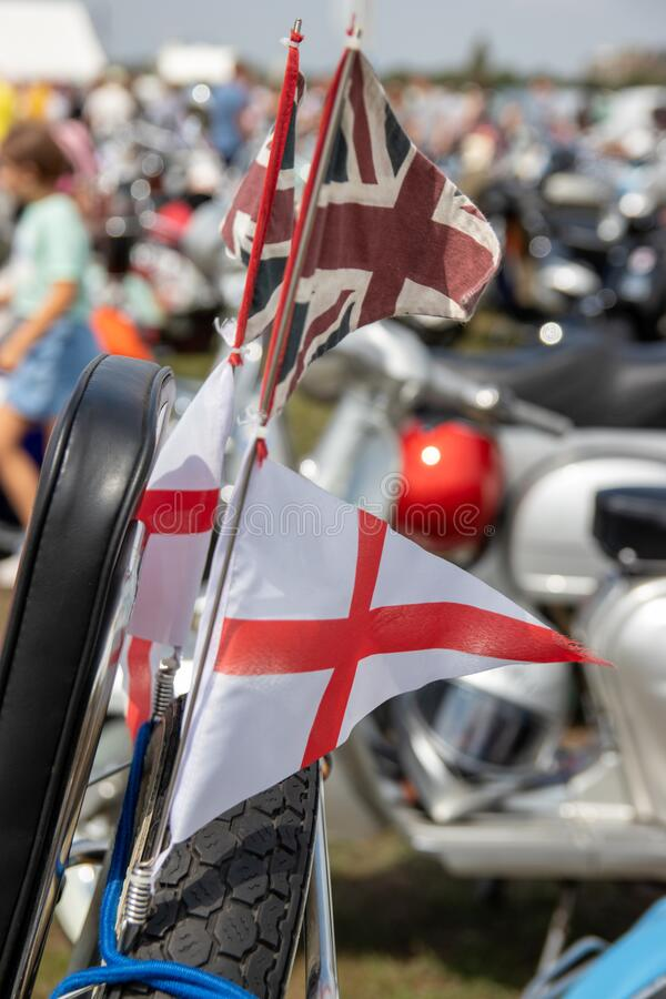 The flag of St George, England flag flying from the back of scooters at a scooter rally stock photos