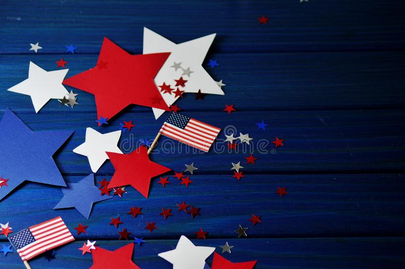 Flag, stars and serpentine on July 4,happy independence day, patriotism, memory of veterans , the concept of independence day. royalty free stock photography