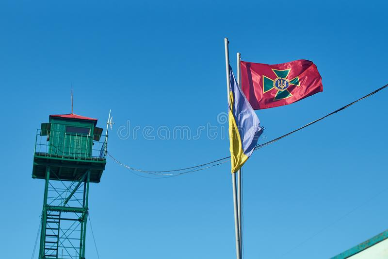 Flag of State Border Guard Service of Ukraine near the state border. Waving flag of State Border Guard Service of Ukraine near the state border stock photos