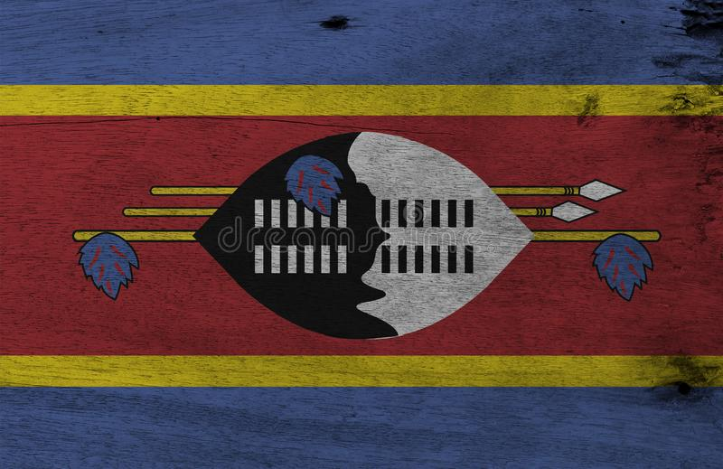 Flag of Swaziland on wooden plate background. Grunge Swazi flag texture. royalty free stock image