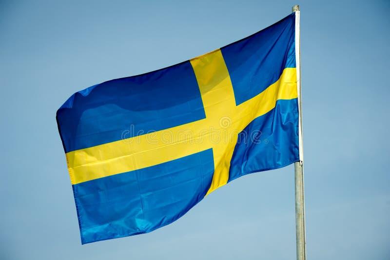 Flag of Sweden. Over blue sky background stock images