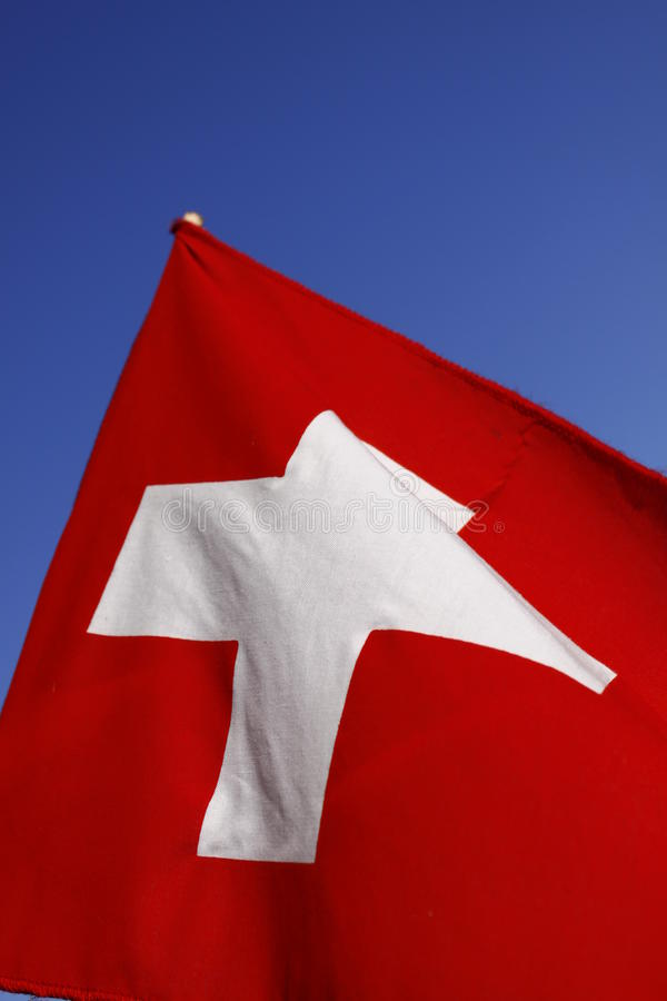 Flag of Switzerland. The flag of Switzerland consists of a red flag with a bold, equilateral white cross in the center. It is one of only two square sovereign stock photography