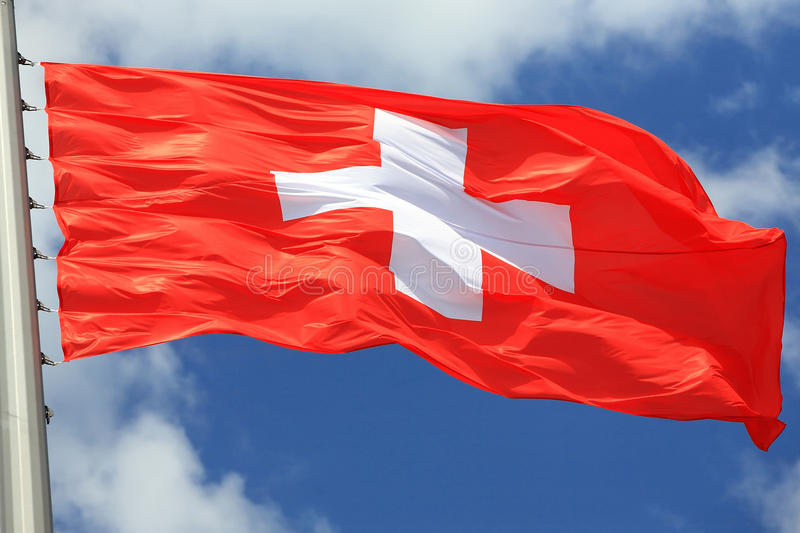 Flag of Switzerland. Against the sky royalty free stock images