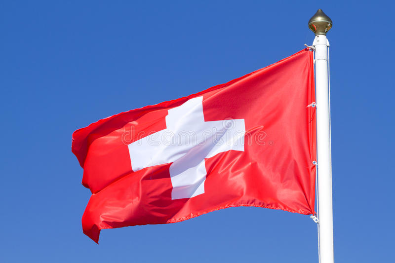 Flag of a Switzerland. On a background blue sky royalty free stock image