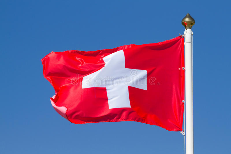 Flag of Switzerland. On a background sky royalty free stock images