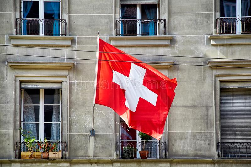 Flag of Switzerland. Is blowing in the wind, Berne city royalty free stock photography