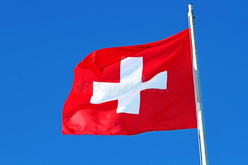 Flag of switzerland. On a flagstaff royalty free stock image