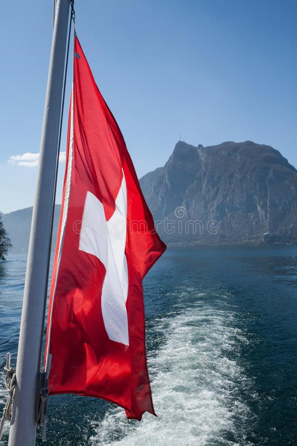 Flag Switzerland. On the water royalty free stock image