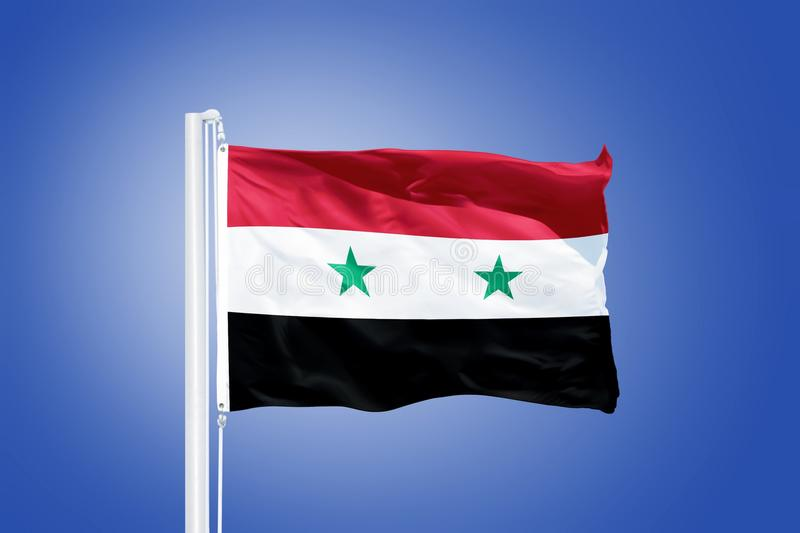 Flag of Syria flying against a blue sky.  royalty free stock photography