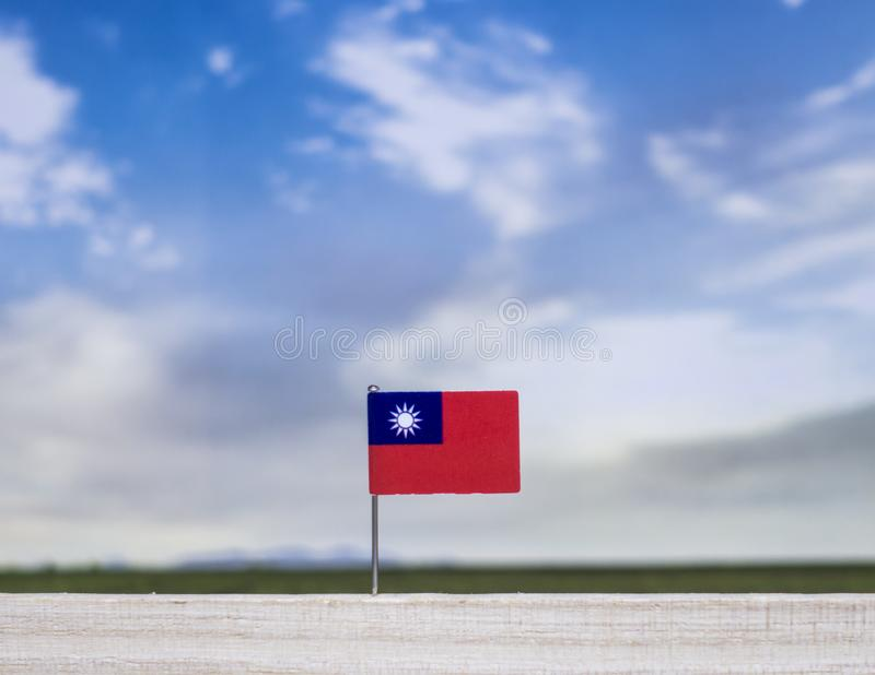 Flag of Taiwan with vast meadow and blue sky behind it. stock images