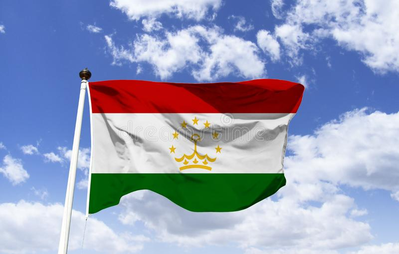Flag of Tajikistan, center a golden emblem. Flag of Tajikistan, three horizontal bands red, white and green. In the center is a golden emblem of a stylized crown stock images