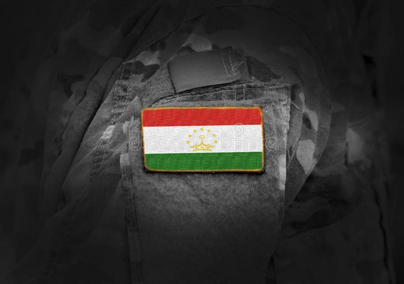 Flag of Tajikistan on military uniform. Army, armed forces, soldiers. Collage royalty free stock image