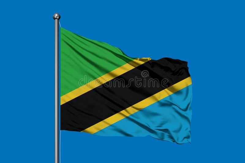 Flag of Tanzania waving in the wind against deep blue sky. Tanzanian flag.  stock photo