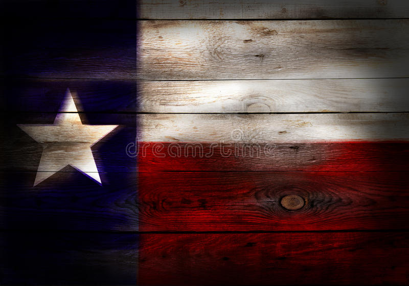 Flag of Texas USA painted on grungy wood plank royalty free stock image