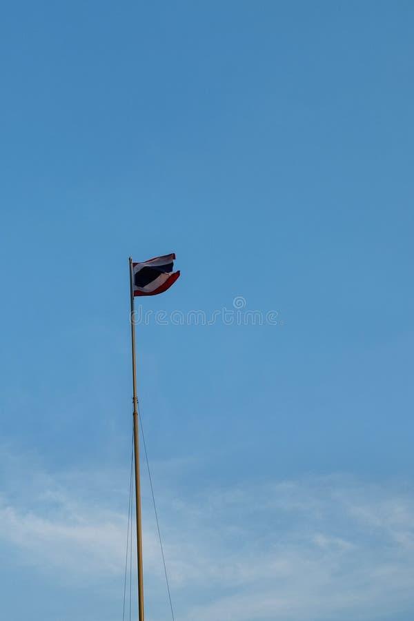 The flag of Thailand wave on a flagpole against a blue sky royalty free stock photos