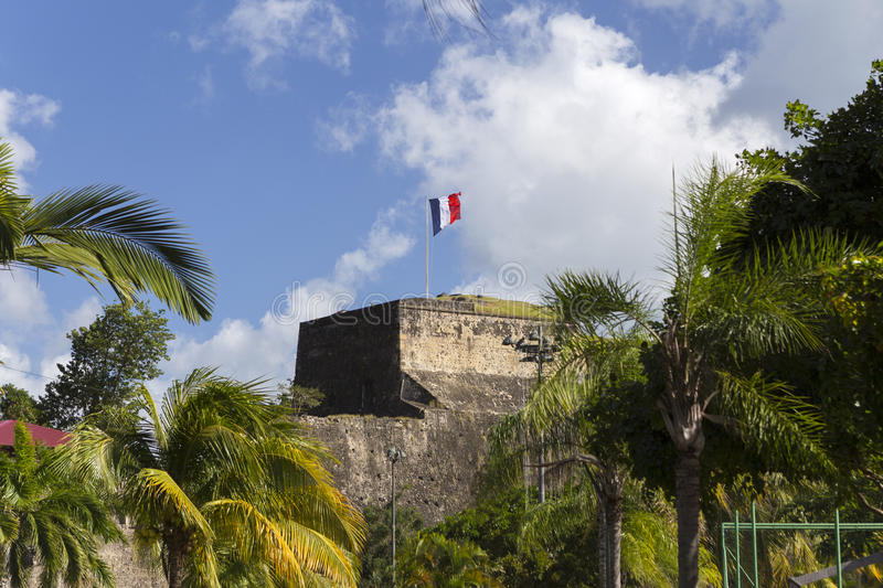 Flag on a top of Fort Saint Louis in Fort-de-France, Martinique. French flag on a top of Fort Saint Louis in Fort-de-France, Martinique royalty free stock image