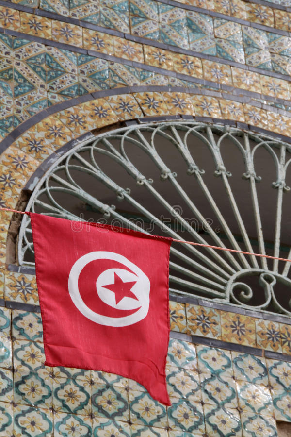 Flag of Tunisia. In front of mosaic royalty free stock image