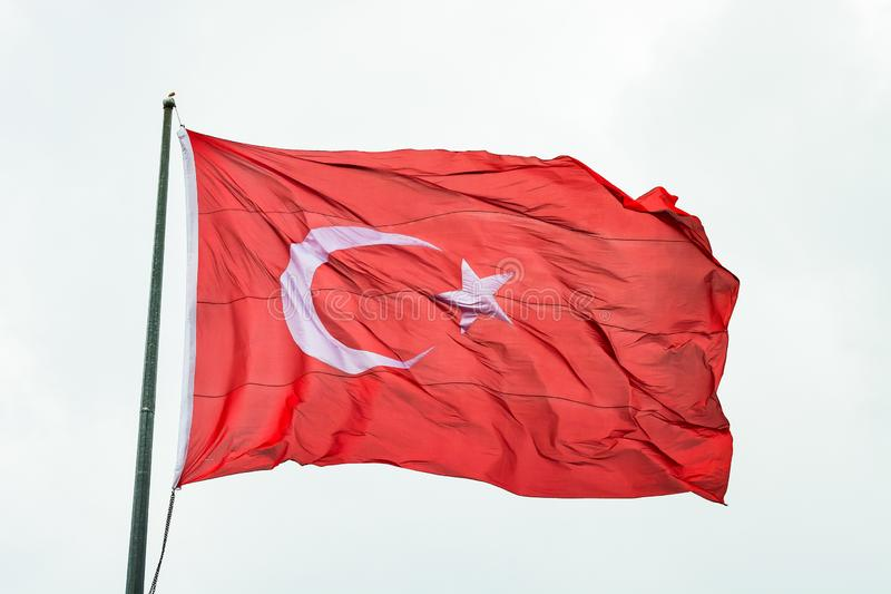 Flag of Turkey flying in the wind.  stock photo