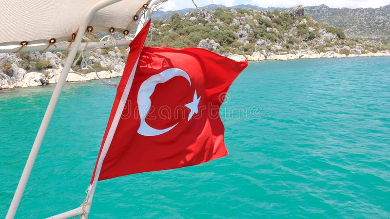 Flag of Turkey waving on a boat Near Antalya Turkey. Shoot in July 2018 royalty free stock images