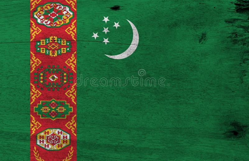 Flag of Turkmenistan on wooden plate background. Grunge Turkmenistan flag texture. stock photography